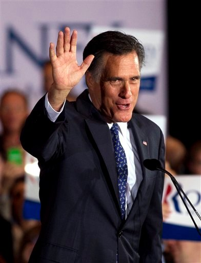 Republican presidential candidate, former Massachusetts Gov. Mitt Romney waves to the crowd during a victory rally in Schaumburg, Ill., after winning the Illinois Republican presidential primary, Tuesday, March 20, 2012. (AP Photo/Steven Senne)
