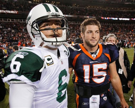 Nov. 17, 2011 file photo, New York Jets quarterback Mark Sanchez (6) and Denver Broncos quarterback Tim Tebow (15) walk off the field together in Denver. Tebow has been traded from the Denver Broncos to the New York Jets. (AP Photo/Barry Gutierrez, File)