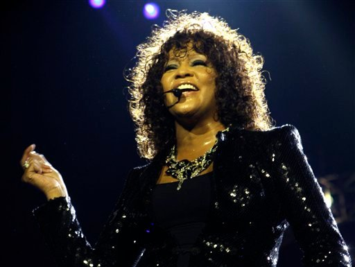 FILE - In this April 25, 2010 file photo, singer Whitney Houston performs at the o2 in London as part of her European tour. (AP Photo/Joel Ryan, file)