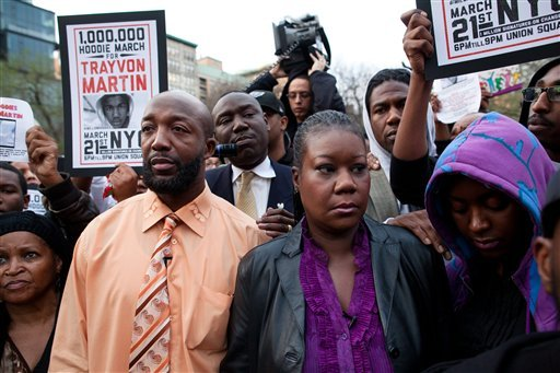 Trayvon Martin's parents Tracy Martin, left, and Sybrina Fulton, center, are joined by an unidentified woman during the Million Hoodie March in Union Square Wednesday, March 21, 2012 in New York. (AP Photo/John Minchillo)