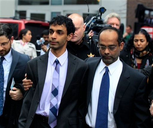 Dharun Ravi, center, is hugged by his father, Ravi Pazhani, right, as they leave court around noon in New Brunswick, N.J., Friday, March 16, 2012. (AP Photo/Mel Evans)