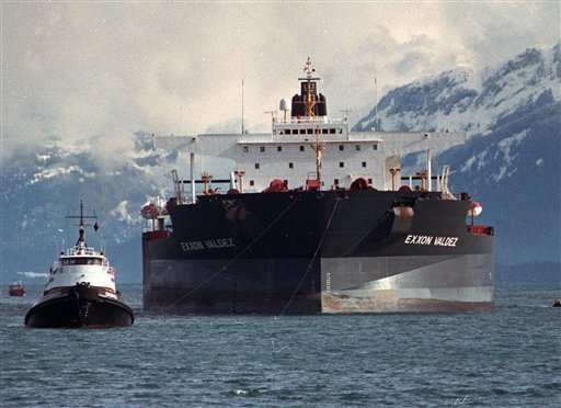 FILE - Tugboats pull the crippled tanker Exxon Valdez towards Naked Island in Prince William Sound, Alaska, seen in this April 5, 1989, file photo after the ship was pulled from Bligh Reef. (AP Photo/Rob Stapleton, File)