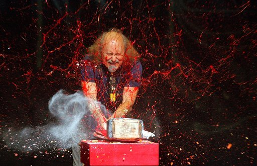FILE - In this Nov. 18, 2006 file photo, comedian Gallagher smashes strawberry syrup and flour at the end of his performance at the Five Flags Theater in Dubuque, Iowa. (AP Photo/Telegraph Herald, Jeremy Portje, File)