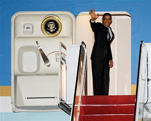 President Barack Obama boards Air Force One, for a flight to South Korea, at Andrews Air Force Base, Md., Saturday, March 24, 2012. (AP Photo/Cliff Owen)