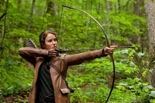 "In this image released by Lionsgate, Jennifer Lawrence portrays Katniss Everdeen in a scene from ""The Hunger Games,"" opening on Friday, March 23, 2012. (AP Photo/Lionsgate, Murray Close)"