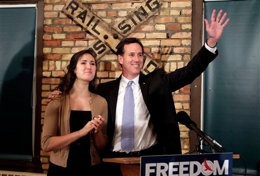 Republican presidential candidate, former Pennsylvania Sen. Rick Santorum, right, is joined by his daughter Sarah Maria during a news conference in Green Bay, Wis., Saturday, March 24, 2012. (AP Photo/Jae C. Hong)