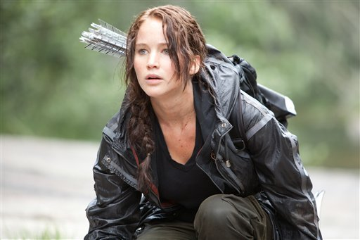 """In this image released by Lionsgate, Jennifer Lawrence portrays Katniss Everdeen in a scene from """"The Hunger Games."""" (AP Photo/Lionsgate, Murray Close)"""