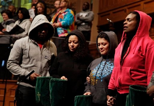 Senior Minister Jacqueline Lewis, right, prays with other congregants during a service at Middle Collegiate Church in New York, Sunday, March 25, 2012. (AP Photo/Seth Wenig)