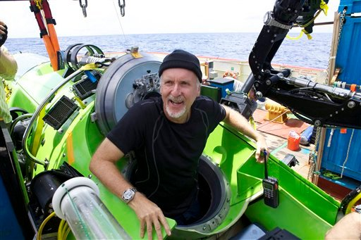 Filmmaker and National Geographic Explorer-in-Residence James Cameron emerges from the Deepsea Challenger submersible after his successful solo dive to the Mariana Trench, the deepest part of the ocean, Monday March 26, 2011.