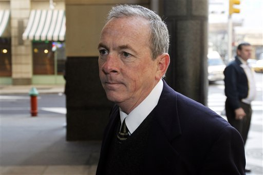 The Rev. James J. Brennan enters the Criminal Justice Center, Monday, March 26, 2012, in Philadelphia. Brennan is charged with raping a 14-year-old boy in 1996. (AP Photo/Matt Rourke)