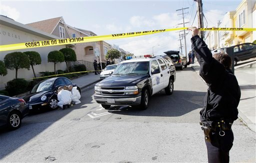 San Francisco Police officers inspect outside of a home on Howth Street in San Francisco, Friday, March 23, 2012. (AP Photo/Jeff Chiu)