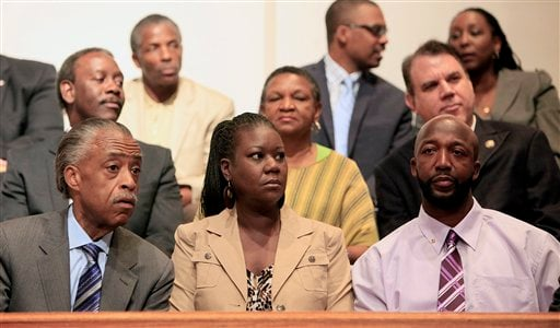 Rev. Al Sharpton, Sybrina Fulton and Tracy Martin, from left, listen during a community forum on slain Florida teenager Trayvon Martin at the Macedonia Baptist Church in Eatonville, Fla., Monday, March 26, 2012. (AP Photo/Julie Fletcher)