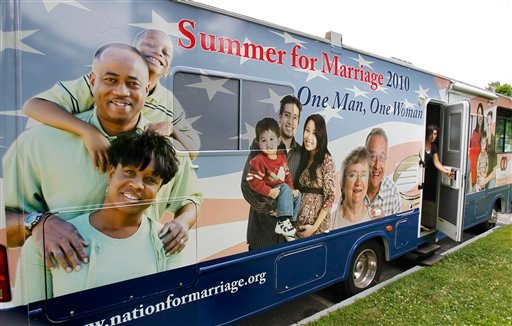 FILE - In this July 14, 2010 file photo, a National Organization for Marriage recreational vehicle gets set to hit the road in Augusta, Maine. (AP Photo/Robert F. Bukaty, File)