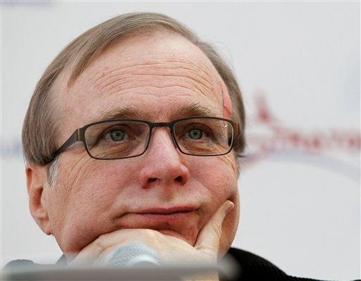 FILE - In this Dec. 13, 2011 photo, Microsoft co-founder Paul Allen listens during a a news conference in Seattle. (AP Photo/Elaine Thompson)