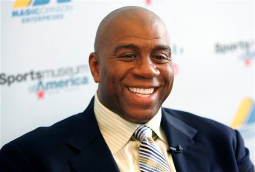 In this Nov. 21, 2008 file photo, basketball legend turned entrepreneur Magic Johnson tours the Sports Museum of America in New York. (AP Photo/Seth Wenig, File)
