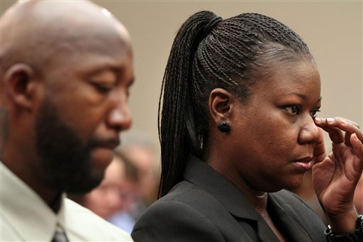 Trayvon Martin's mother Sybrina Fulton, and father, Tracy Martin attend a House Judiciary Committee briefing on racial profiling and hate crimes, Tuesday, March 27, 2012, on Capitol Hill, in Washington. (AP Photo/Jacquelyn Martin)
