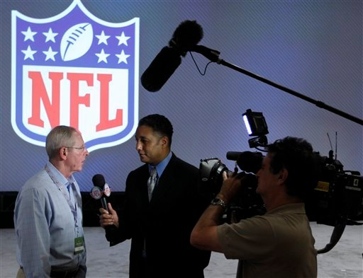New York Giants coach Tom Coughlin, left, gives an interview at the NFL owners meeting in Palm Beach, Fla., Wednesday, March 28, 2012.