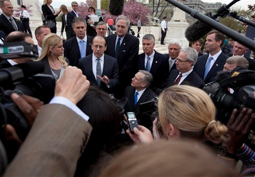 Paul Clement, a lawyer for 26 states seeking to have the Patient Protection and Affordable Care Act tossed out in its entirety, gestures as he speaks to reporters in front of the Supreme Court in Washington, Wednesday, March 28, 2012.