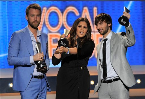 From left, Charles Kelley, Hillary Scott and Dave Haywood of musical group Lady Antebellum accept the award for vocal group of the year at the 47th Annual Academy of Country Music Awards on Sunday, April 1, 2012 in Las Vegas. (AP Photo/Mark J. Terrill)