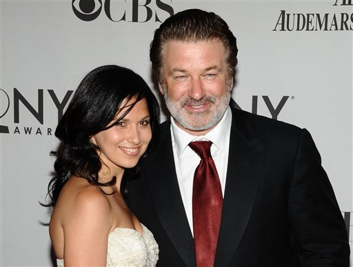 ILE - In this June 12, 2011 file photo, Alec Baldwin, right, and Hilaria Thomas arrive at the 65th annual Tony Awards in New York. Baldwin proposed to Thomas over the weekend. They began dating last year.