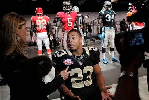 New Orleans Saints' Pierre Thomas talks to a reporter at a presentation in New York, Tuesday, April 3, 2012. The NFL and Nike showed off the new gear in grand style with a gridiron-themed fashion show at a Brooklyn film studio. (AP Photo/Seth Wenig)