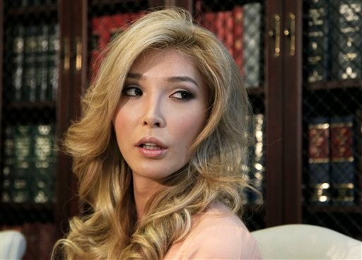 Jenna Talackova, who advanced to the finals of the Miss Canada competition, part of the Miss Universe contest, and was recently forced out of the competition, appears with her attorney Gloria Allred in LA April 3, 2012. (AP Photo/Reed Saxon)