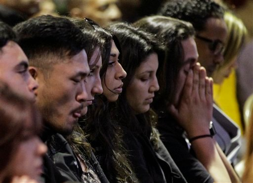 Mourners attend a memorial service at the Allen Temple Baptist Church Tuesday, April 3, 2012, in Oakland, Calif. (AP Photo/Ben Margot)