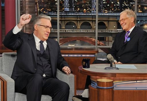 "In this photo provided by CBS, talk show host Keith Olbermann, left, chats with host David Letterman on the set of the ""Late Show with David Letterman,"" Tuesday April 3, 2012 in New York."