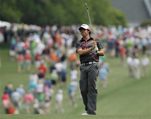 Rory McIlroy, of Northern Ireland, watches his shot from the first fairway during a practice round for the Masters golf tournament Tuesday, April 3, 2012, in Augusta, Ga. (AP Photo/Charlie Riedel)