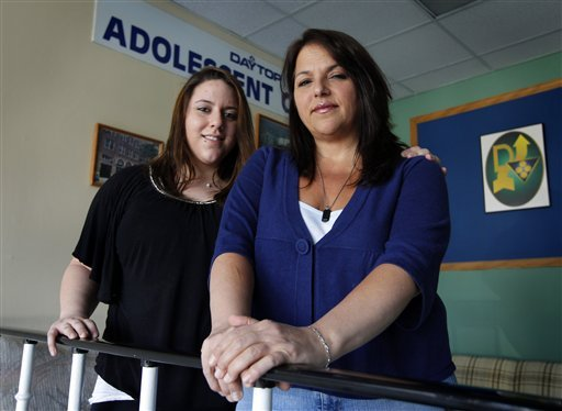In this March 30, 2012, photo, Makenzie Emerson, 19, left, and her mother, Phyllis Ferraro, 46, both of East Islip, N.Y., at Daytop Suffolk Outreach center in Huntington Station, N.Y. Emerson had developed an addiction to pain killers.(AP Photo/John Dunn)