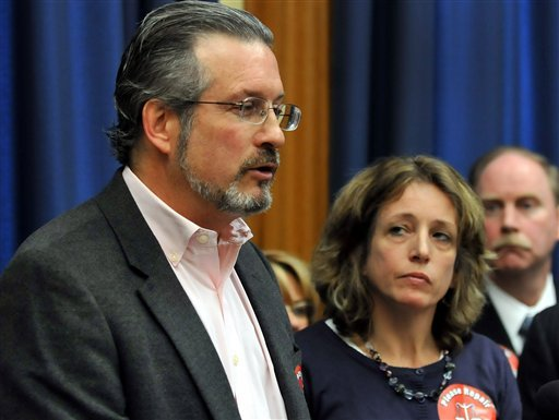 In this Wednesday, April 4, 2012, file photo, Dr. William Petit Jr., left, speaks to the media as his sister Johanna Chapman looks on at the Capitol in Hartford, Conn. (AP Photo/Journal Inquirer, Jim Michaud)