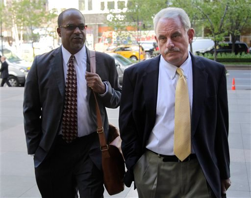 New Orleans Saints assistant coach Joe Vitt, right, arrives with attorney David Cornwell for a meeting at NFL headquarters in New York, Thursday, April 5, 2012.