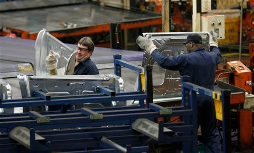 In this April 4, 2012 photo, auto workers at the Ford Stamping Plant stack the inner door panel for the Ford Explorer, in Chicago Heights, Ill. (AP Photo/Charles Rex Arbogast)