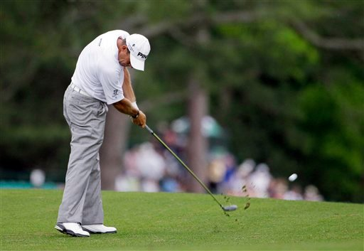 Lee Westwood, of England, hits his second shot on the 15th hole during the first round the Masters golf tournament Thursday, April 5, 2012, in Augusta, Ga.