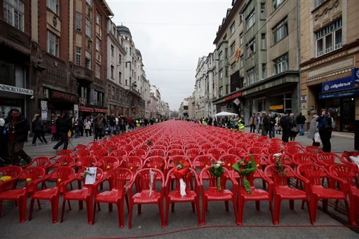 Red chairs are displayed along a main street in Sarajevo as the city marks the 20th anniversary of the start of the Bosnian war on Friday, April,6, 2012. (AP)