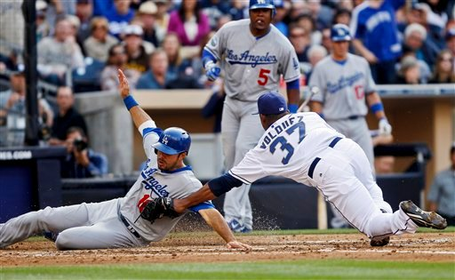 Los Angeles Dodgers' Andre Ethier is tagged out at home by San Diego Padres pitcher Edinson Volquez while trying to score from third on a wild pitch in the fourth inning of a baseball game, Thursday, April 5, 2012, in San Diego.