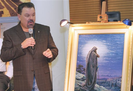 "In this Sept. 15, 2006 file photo, artist Thomas Kinkade unveils his painting, ""Prayer For Peace,"" at the opening of the exhibit ""From Abraham to Jesus,"" in Atlanta. (AP)"