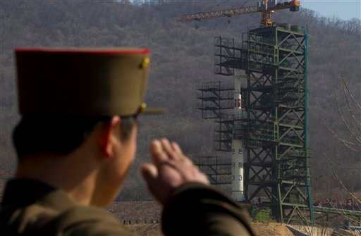A North Korean soldier salutes in front of the country's Unha-3 rocket, slated for liftoff between April 12-16, at Sohae Satellite Station in Tongchang-ri, North Korea on Sunday April 8, 2012. (AP)