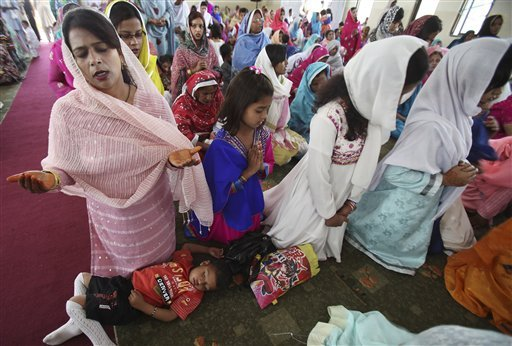Pakistani Christians pray during Easter mass at St. John's Church in Peshawar, Pakistan, Sunday, April 8, 2012. (AP Photo/Mohammad Sajjad)