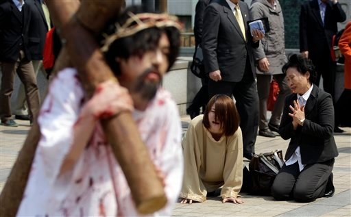 A South Korean Christian devotees reenact Jesus' path to his crucifixion during a performance for the Easter in Seoul, South Korea, Sunday, April 8, 2012. (AP)