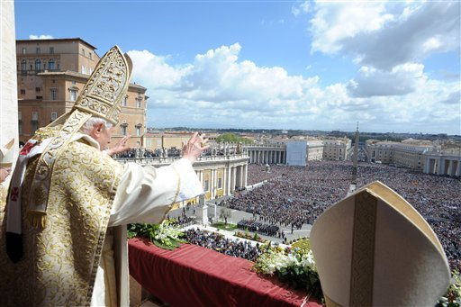 In this picture made available by the Vatican newspaper Osservatore Romano, Pope Benedict XVI greets the faithful after the Urbi and Orbi blessing at the end of the Easter Mass in St. Peter's Square at the the Vatican Sunday, April 8, 2012. (AP)