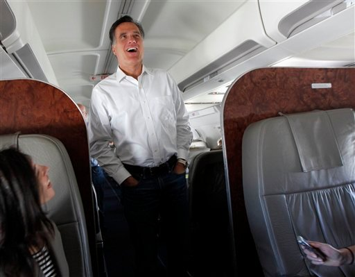 FILE - In this Feb. 1, 2012, file photo Republican presidential candidate, former Massachusetts Gov. Mitt Romney talks to reporters on his campaign plane en route from Tampa, Fla. to Minnesota and Nevada. (AP Photo/Gerald Herbert, File)