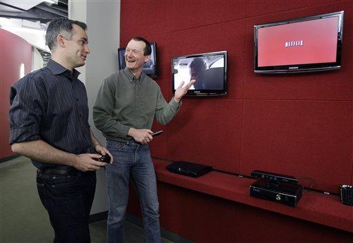 In this March 20, 2012, photo, Netflix executives John Ciancutti, left, and Neil Hunt talk at the Netflix headquarters in Los Gatos, Calif. (AP Photo/Paul Sakuma)