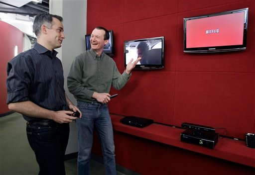 In this March 20, 2012, photo, Netflix executives John Ciancutti, left, and Neil Hunt talk at the Netflix headquarters in Los Gatos, Calif. (AP Photo/Paul Sakuma)