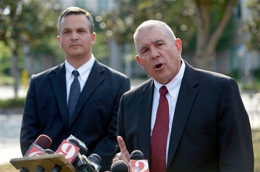 Hal Uhrig, right, and Craig Sonner, former attorneys for George Zimmerman, speak to reporters during a news conference to announce that both attorneys had quit as Zimmerman's legal representatives in Sanford, Fla., Tuesday, April 10, 2012. (AP Photo)