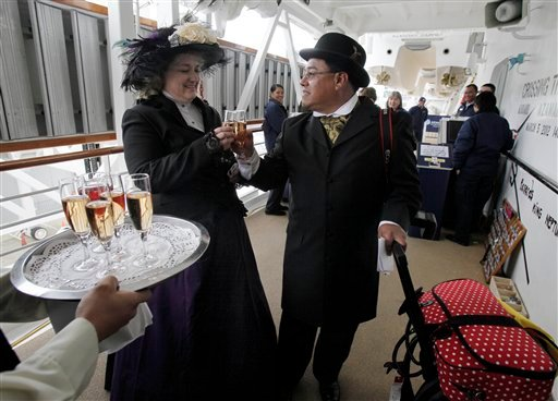 Laurie and Dan Castaneda, from Long Beach, Calif., toast with their welcome glass of champagne as they board the Titanic Memorial Cruise, aboard the Azamara Journey, bound for for Halifax, Nova Scotia, in New York, Tuesday, April 10, 2012. (AP Photo)