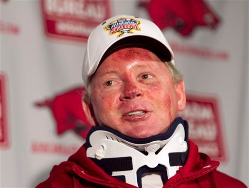 FILE - In this April 3, 2012, file photo, Arkansas football coach Bobby Petrino speaks during a news conference in Fayetteville, Ark., after being released from a hospital after he was injured in a motorcycle accident. (AP Photo/Gareth Patterson, File)