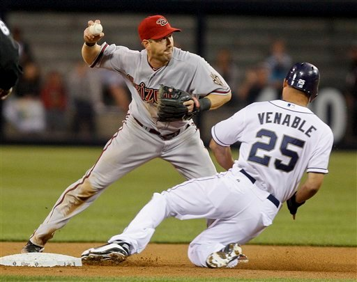 Arizona Diamondbacks shortstop Willie Bloomquist avoids the slide of San Diego Padres' Will Venable while relaying to first to complete a double play in the first nning of a baseball game Tuesday, April 10, 2012 in San Diego.