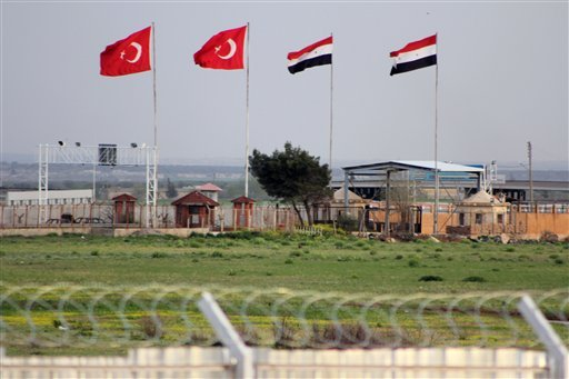 his Tuesday, April 10, 2012, photo shows the border crossing between Turkey and Syria from a refugee camp near the border, in Kilis, Turkey. (AP Photo/Germano Assad)