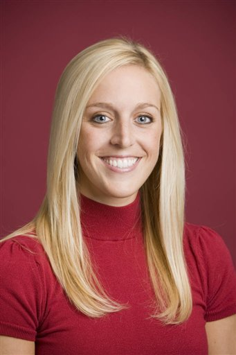 In this undated image released by the University of Arkansas, Razorback Foundation assistant director Jessica Dorrell poses for a photo. (AP Photo/University of Arkansas, Wesley Hitt, File)